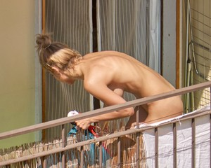 Hot-girl-sunbathing-naked-on-the-balcony-%5Bx18%5D-b700ipgzj0.jpg